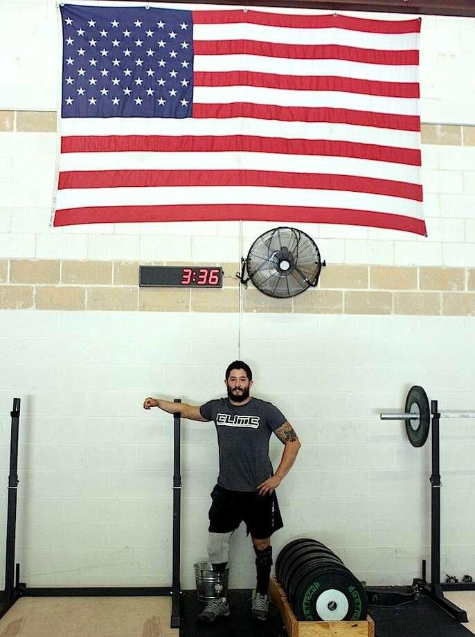 Nick Perales poses under his beloved American flag. Photo: Stacey Glaessman