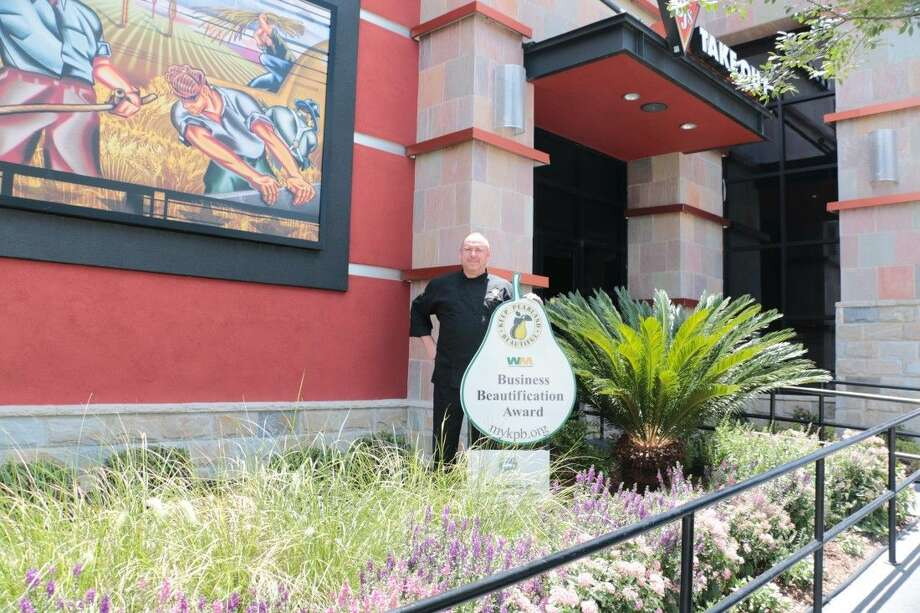 Recently BJ's Restaurant and Brewery General Manager Terry Allison accepted the July Business Beautification Award from Keep Pearland Beautiful. BJ's Restaurant landscaping is full of color with a great selection of native and adaptive flowers, shrubs and grasses. Photo: File Photo