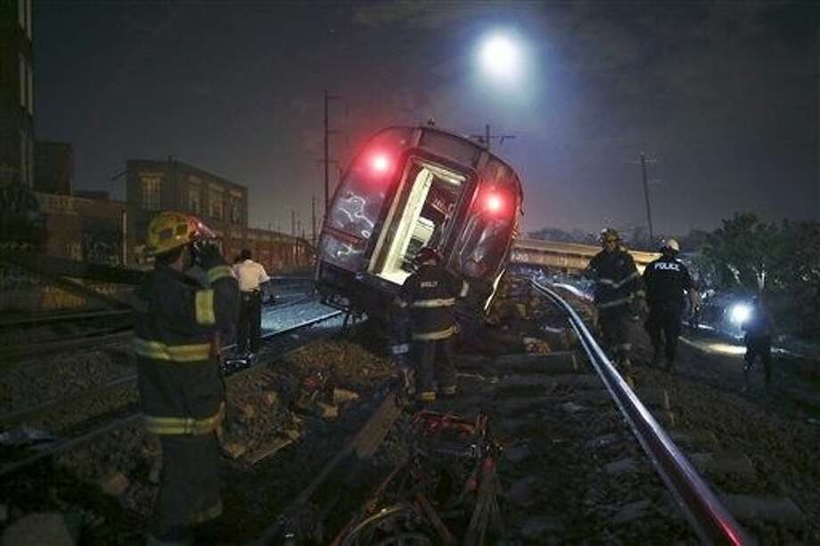 FILE - In this May 12, 2015 file photo, emergency personnel work the scene of a deadly train wreck in Philadelphia. An Amtrak train headed to New York City derailed and tipped in Philadelphia. Despite several years of horrific oil train wrecks and record car and truck recalls, congressional Republicans have decided that the auto and railroad industries suffer from too much safety regulation, not too little. Photo: Joseph Kaczmarek