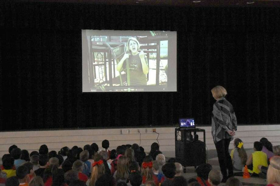 "Rennell Elementary School students watch the premiere of the STAAR-themed music video, ""Hello STAAR,"" on March 24 in the school cafeteria. The music video was created by Rennell staff to motivate students as they prepare for this week's STAAR tests."