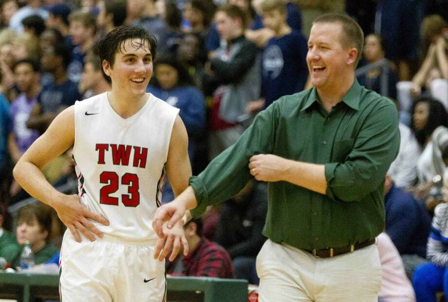 The Woodlands point guard Jack Hammett shares a laugh with head coach Dale Reed during the fourth quarter of a District 16-6A basketball game Friday, Jan. 8, 2016, at The Woodlands High School. Go to HCNpics.com to purchase this photos, and other like it.