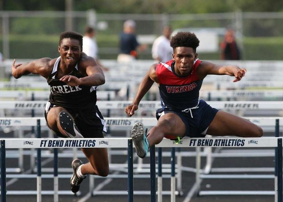 Dulles' Jimmie Washington (right) qualified for the 2016 Texas Relays in the 110-meter hurdles. Washington was an area runner-up and regional finalist in the event last year. Photo: HCN File Photo