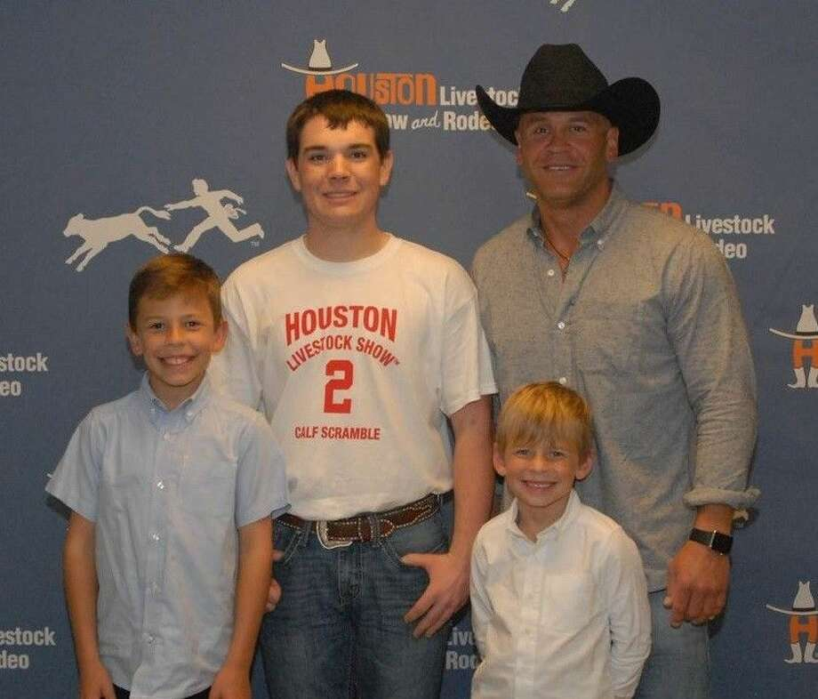 Tyler Hamic of Tarkington FFA was successful in the March 8 calf scramble at the Houston Livestock Show and Rodeo. Photo: Submitted