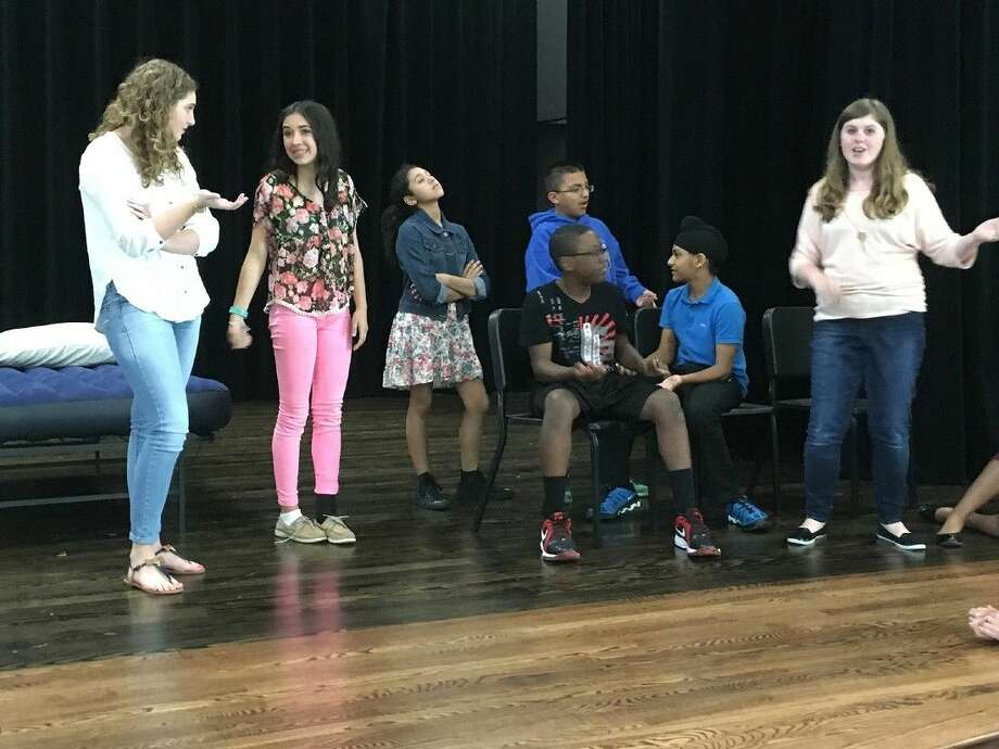 Anthony Middle School students rehearse a scene from their upcoming One Act Play, John Lennon and Me. Pictured, from left, are: Isabella Hall, Maddie Dupont, Amanda Tello, Gabriel Lopez (standing), Jessie Bess, Rajveer Kindra and Ashely Hoover.