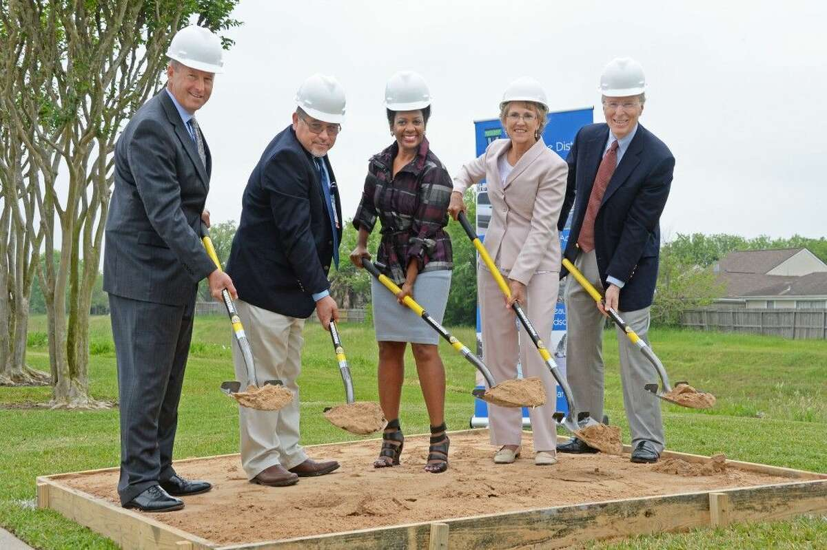 Westchase GM Jim Murphy, TxDOT Construction Director Lucio Ortiz, Gwen Tillotson, Sandra Musgrove and Philip Musgrove flip some dirt at the Brays Bayou Connector Trail near Harwin Drive to symbolize the beginning of work on the project.