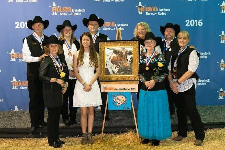 Christina Rasmussen with the group of buyers at the Houston Livestock Show and Rodeo auction of rodeo artwork.