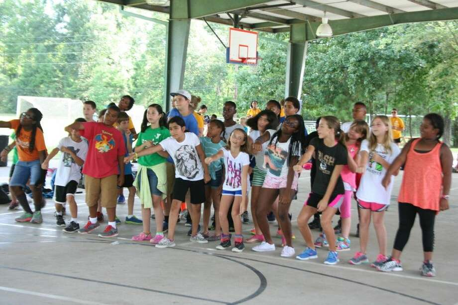 Summer campers perform a repeat after me skit during the Lake Houston Family YMCA Summer Day/Teen Camp experience July 11, 2015.