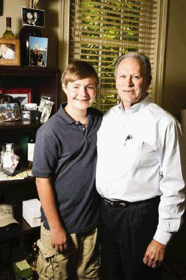 Reese Wilson, 14, of The Woodlands, poses for a portrait with his grandfather, Virgil Yoakum, vice president and general manager of Woodforest Development Company. Photo: Michael Minasi