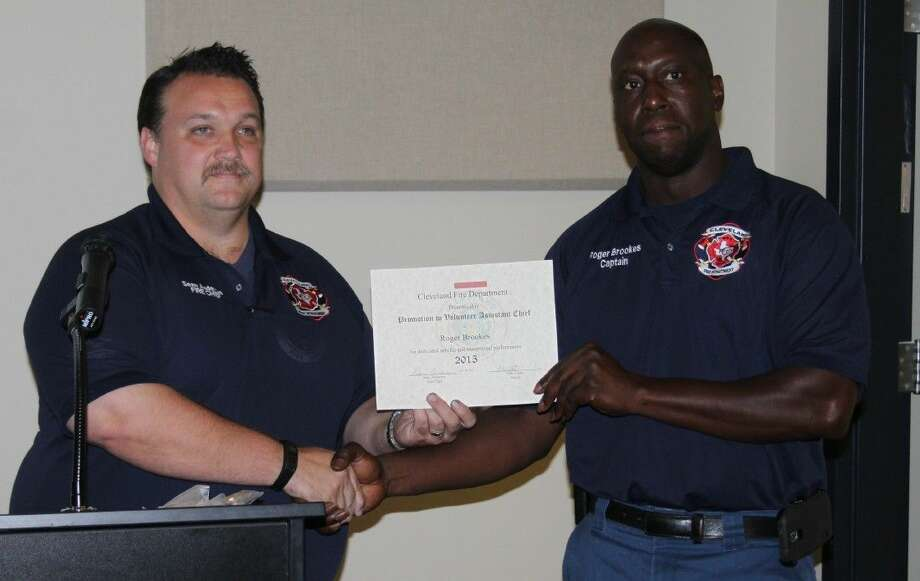 Cleveland Fire Chief Sean Anderson (left) presents a certificate to the new Volunteer Assistant Chief Roger Brookes. Photo: Jacob McAdams