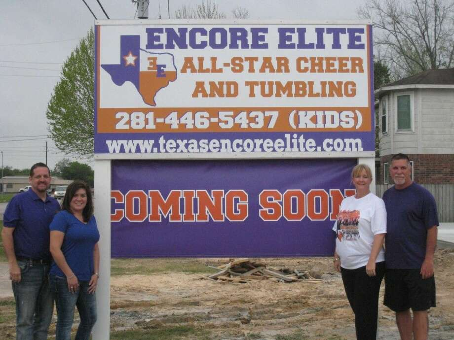 Justin and Yvonne Cassell, left, with Kris and Stacy Williams, right, prepare to open Encore Elite All-Star Cheer and Tumbling in Humble in May.