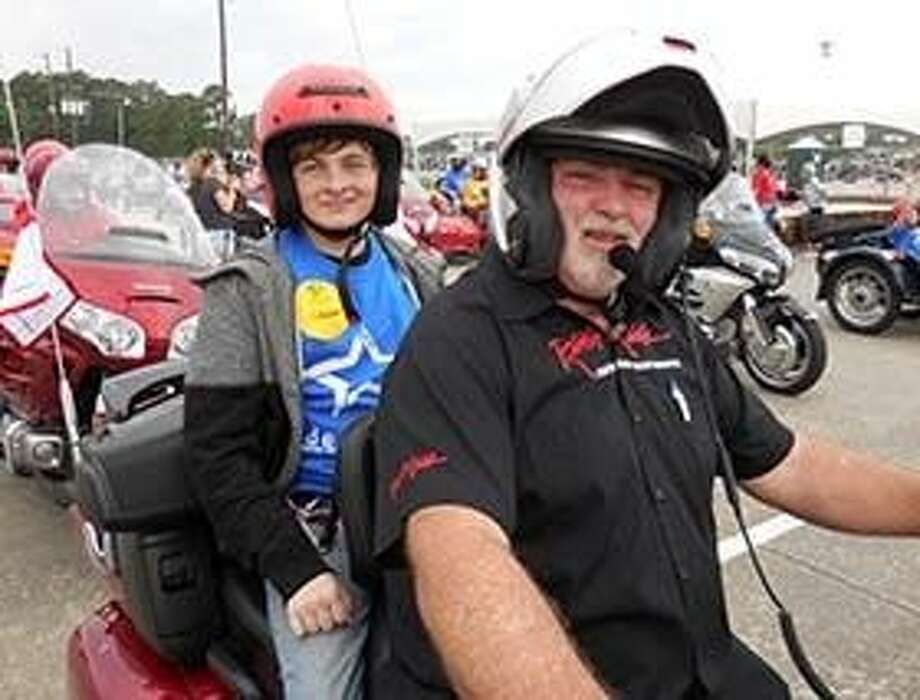Star Garrett with escort Steve Ferguson lead the 2015 Houston Ride for Kids ride.