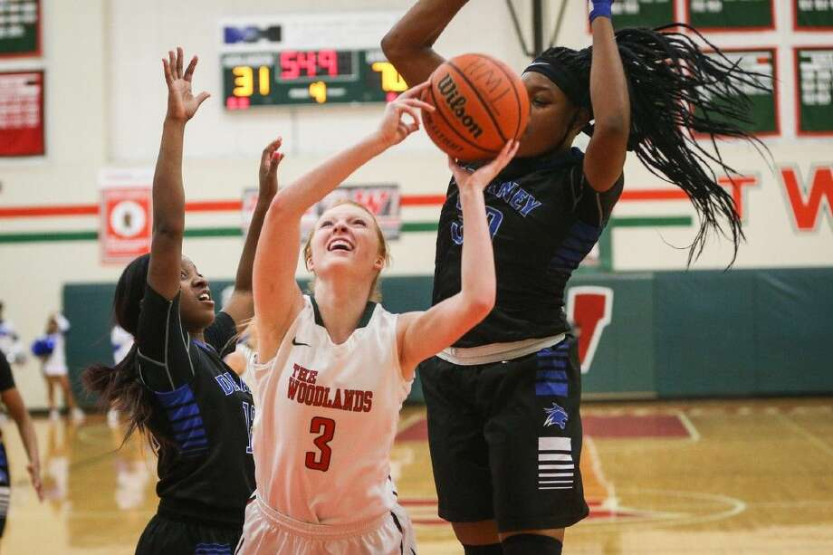 The Woodlands' Madison McGurrin (3) shoots for the basket during the high school girls basketball game against Dekaney on Monday, Feb. 15, 2016, at The Woodlands High School. To view more photos from the game, go to HCNPics.com.