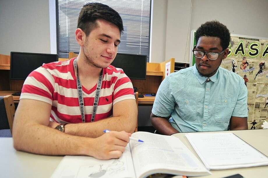 Student tutor Oliver Perrett, left, provides study tips for San Jacinto College pharmacy technician student Fred Smith in the North Campus student success center. The College's Points of Contact initiative introduces new students to tutoring and a wide range of other helpful services. Photo credit: Rob Vanya, San Jacinto College marketing, public relations, and government affairs department.