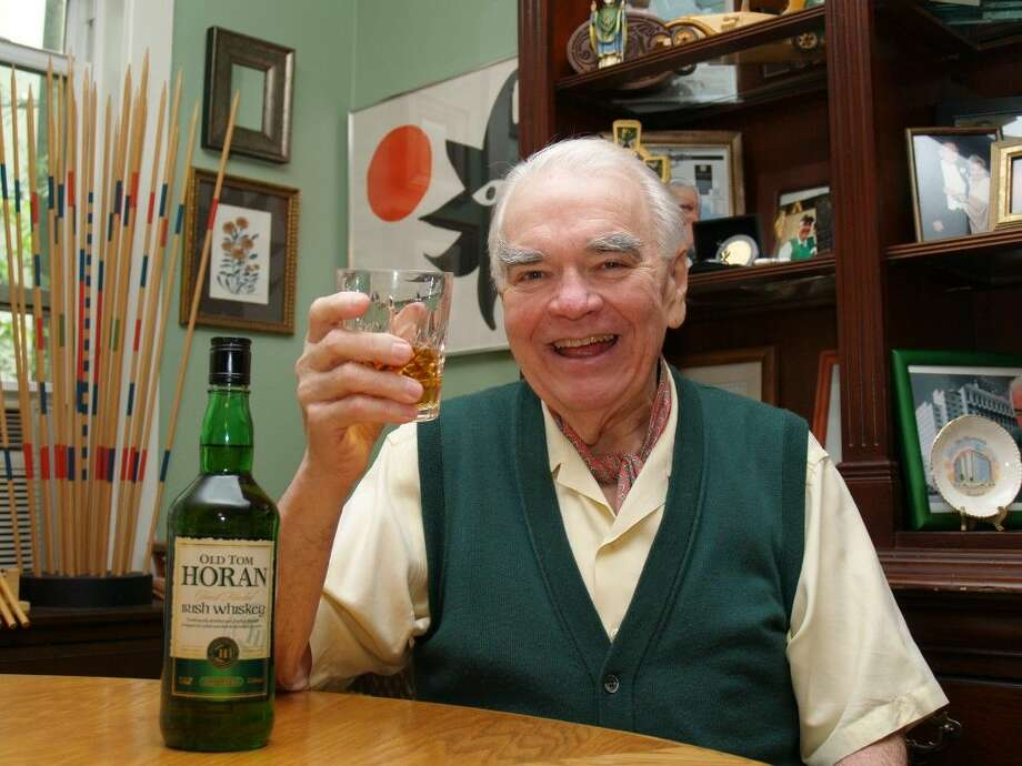 Tom Horan makes a toast with a glass of 'Old Tom Horan Irish Whiskey,' the whiskey named in his honor.