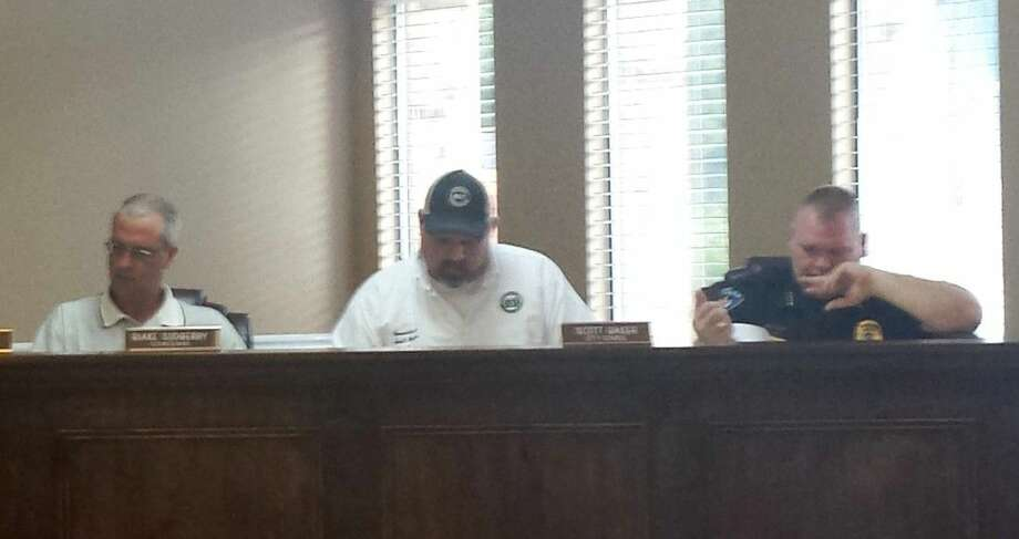 Roman Forest City Councilmen Blake Sudberry and Scott Baker, along with Roman Forest Police Chief Stephen Carlisle, were among those present at the Aug. 12 city council meeting. Photo: STEPHANIE BUCKNER