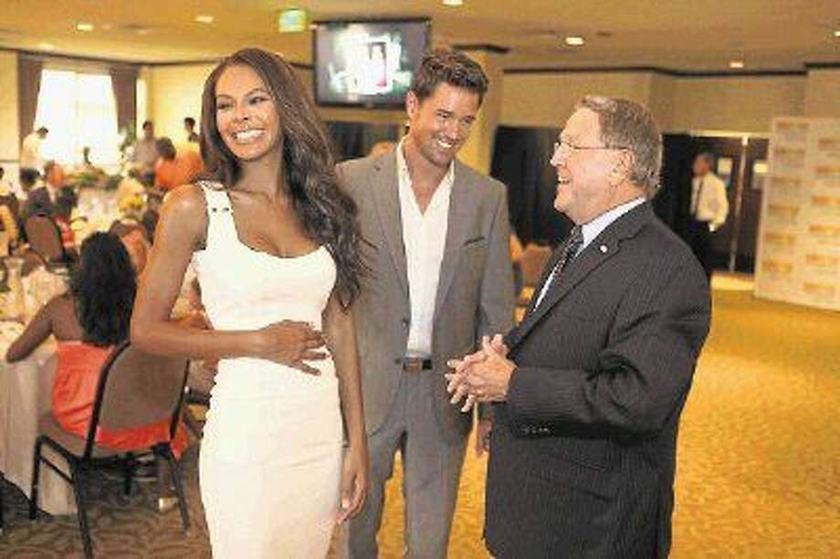 Missouri City Mayor Allen Owen (right) talks with former Miss USA Crystle Stewart, a Missouri City native, who will be married Belgian born model, Max Sebrechts (middle) in Houston this past weekend. Stewart was honored by the city during a ceremony at the City Centre at Quail Valley in Missouri City on Friday, Aug. 8. Photo: Alan Warren