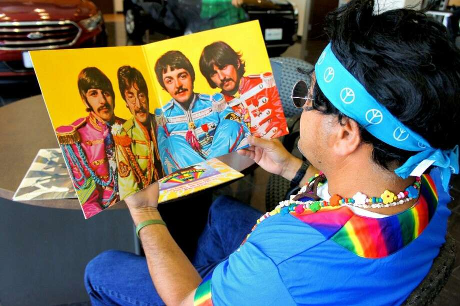 Admiring the colorful attire of the Fab Four is Fort Bend Seniors' Board Chairman Ray Aguilar. Photo: Submitted Photo
