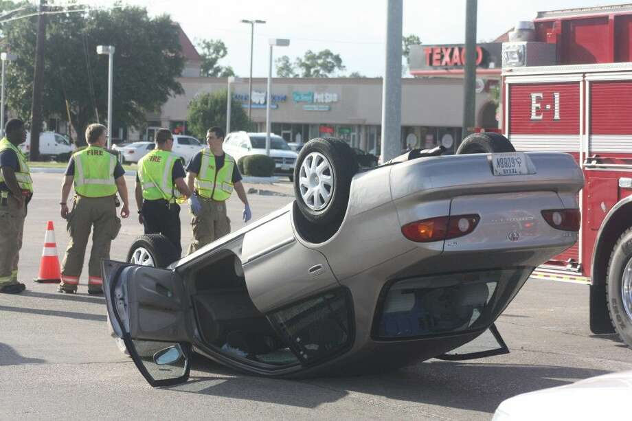 This Corolla flipped completely over onto its roof Saturday, leaving the driver, described as an 87-year-old woman, upside down, held to her seat by the seatbelt she was wearing.
