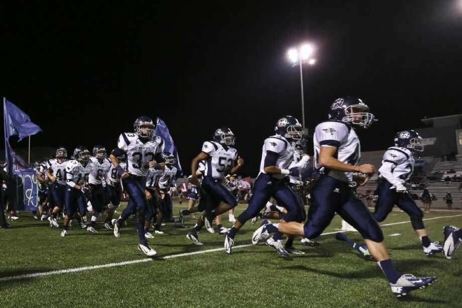 Tomball Memorial Wildcats take the field before the start of the game against Reagan on Thursday at Delmar Stadium. Reagan beat Tomball Memorial 7-0. To view or purchase this photo and others like it, go to HCNPics.com. Photo: Michael Minasi