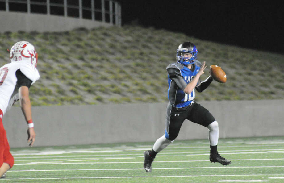 New Caney's Timmy Ware rolls out to make a pass against Crosby at Texan Drive Stadium on Friday in New Caney. Photo: Keith MacPherson