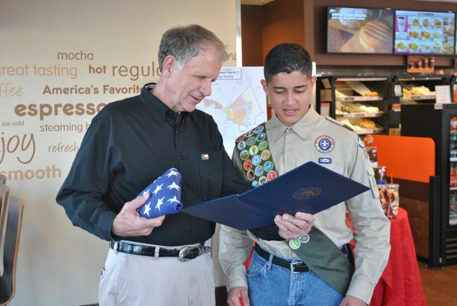 """During Congressman Ted Poe's recent """"Congress after Hours"""" meeting on Aug. 14 with area citizens in the Atascocita-Summerwood area, Eagle Scout Rank award recipient Aaron Escobar received a special recognition award and a flag flown over the Capitol in his honor from the Congressman for his recent achievement."""