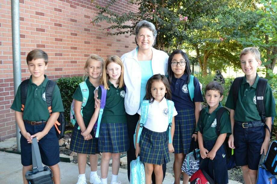 Principal Margaret Morgan welcoming students back to school on the first day, pictured are, from left, Luke Ubanoski, Trinity and Juliette Terrasson, Jilly and Nica Luna, Logan Ubanoski,and new student, Ethan Miller.