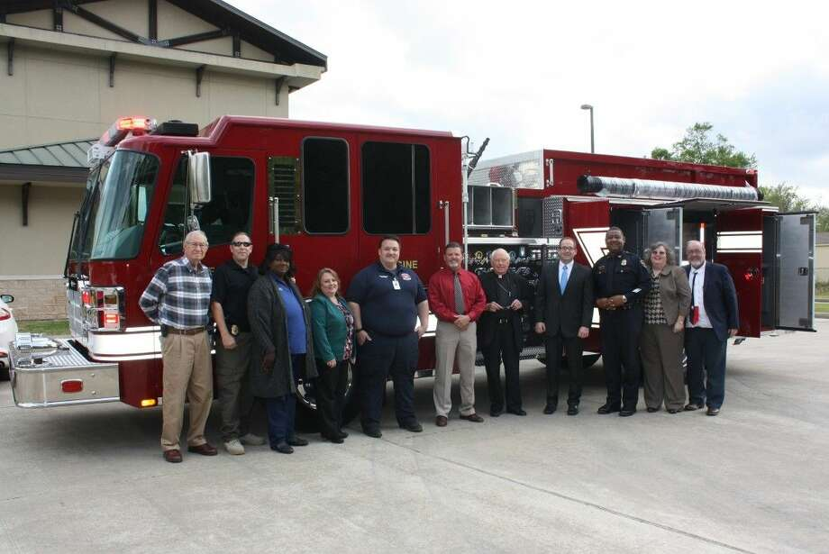 City and community leaders stand before Cleveland Fire Department's new pumper truck prior to the start of the March 22 city council meeting. The truck is the first new pumper or ladder truck purchased by the city since 1979. All others came to the department as used equipment. Pictured left to right are Fred Terrell, Police Capt. Scott Felts, Councilwoman Delores Terry, City Manager Kelly McDonald, Fire Chief Sean Anderson, Mayor Niki Coats, Father James Monroe of Holy Cross Anglican Church, Finance Director Bobby Pennington, Police Chief Darrel Broussard, Head Librarian Mary Cohn and Councilman Otis Cohn. Photo: Vanesa Brashier