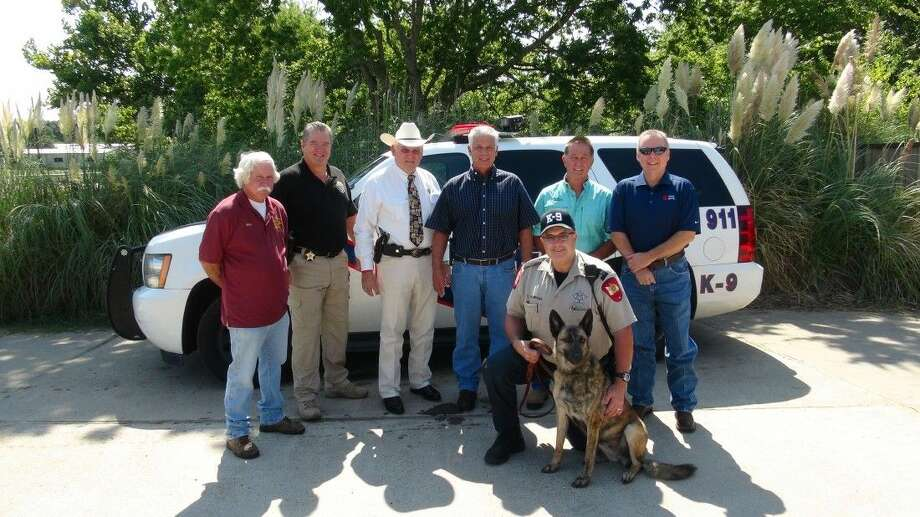 Senna is the new K-9 unit for the Montgomery County Sheriff's Office. Pictured left to right, standing, are Mike Manning, Special Investigations Unit Commander Philip Cash, Montgomery County Sheriff Tommy Gage, Jim Morris, Vernon Miller and Jed Crow. Kneeling are Montgomery County Sheriff's Deputy Tom Thompson and Senna.