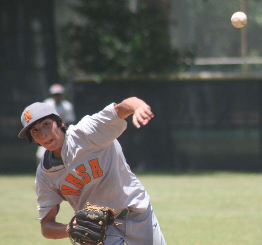 NASA-Orange pitcher Daniel Carmona delivers a pitch to the plate during sixth-inning action at Bay Area Park Sunday afternoon. NASA-Orange is packing its bags for Burleson and the South Zone tourney after winning in dramatic fashion over Friendswood Monday in nine innings. Photo: Robert Avery