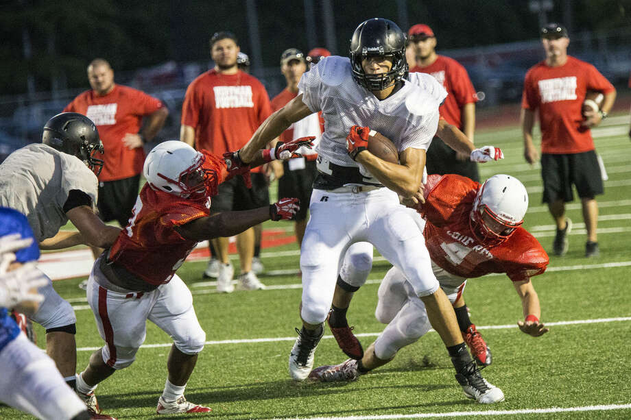 Crosby takes on Huffman in a scrimmage Aug. 15, 2014, at Crosby High School. Photo: Andrew Buckley