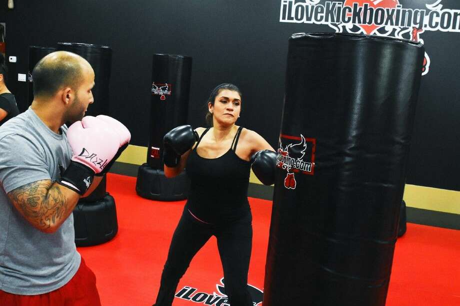 Kickboxing instructor Faisal Raltman observes student Lara Barringers punching techniques during kickboxing classes. Photo: Tony Gaines
