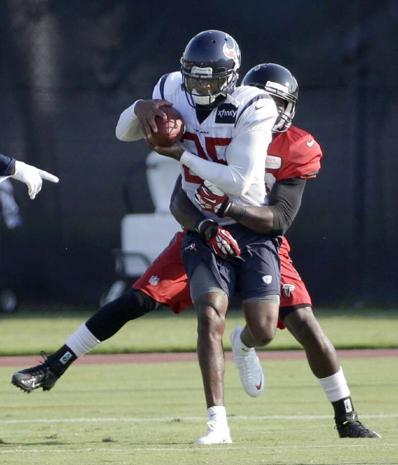 Houston Texans cornerback Kareem Jackson intercepts a pass intended for Atlanta Falcons wide receiver Freddie Martino in practice Thursday. The Texans face the Falcons in an exhibition game Saturday.