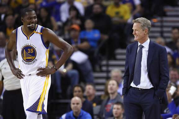 OAKLAND, CA - OCTOBER 04:  Head coach Steve Kerr of the Golden State Warriors talks to Kevin Durant #35 during their preseason game against the Los Angeles Clippers at ORACLE Arena on October 4, 2016 in Oakland, California.  NOTE TO USER: User expressly acknowledges and agrees that, by downloading and or using this photograph, User is consenting to the terms and conditions of the Getty Images License Agreement.  (Photo by Ezra Shaw/Getty Images)