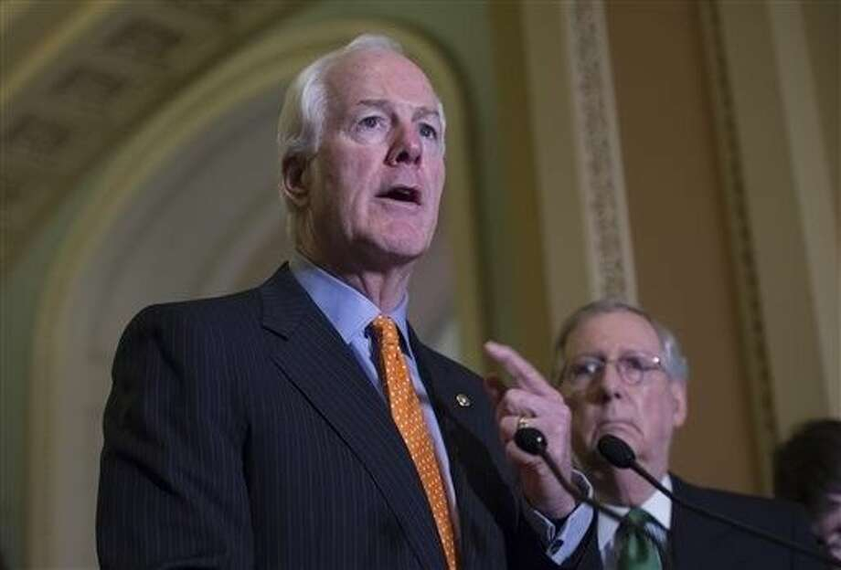 """FILE — In this June 9, 2015, file photo, Senate Majority Whip John Cornyn of Texas, speaks next to Senate Majority Leader Mitch McConnell of Ky. during a news conference on Capitol Hill. Congress' mid-summer to-do list may take until Christmas to clear. """"We're going to leave that fight 'til September, October, November, December,"""" Cornyn, told reporters last week, referring to spending issues and raising the prospect of Christmas in the Capitol. Photo: Molly Riley"""