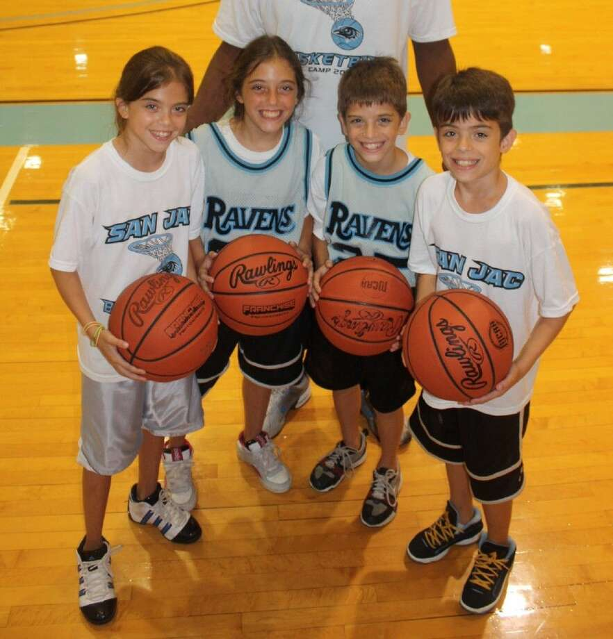 "The Ravens coaching staff gets all kinds of pint-size basketball players at their annual camp, including these quadruplets who took part one year. Two of the ""quads"" are wearing old San Jac uniforms that the staff lets the kids wear for games. Photo: Robert Avery"