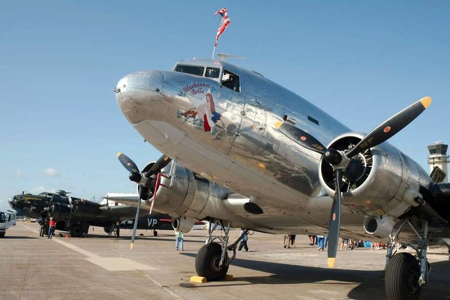 """The """"Texas Raiders"""" vintage B-17 Flying Fortress sits beside """"Bluebonnet Belle,"""" a Douglas C-47 Skytrain for the 1940 Air Terminal Museum """"Wings and Wheels"""" event at Houston Hobby Airport Saturday, Aug 16. Photo: Kirk Sides"""