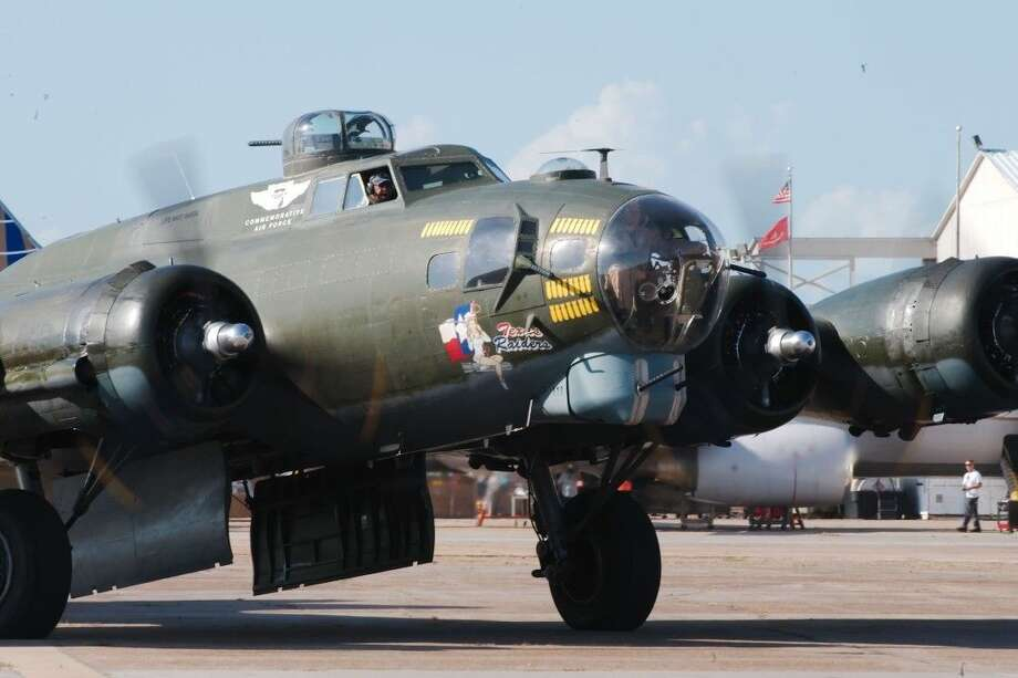 """The """"Texas Raiders"""" vintage B-17 Flying Fortress lands for the 1940 Air Terminal Museum """"Wings and Wheels"""" event at Houston Hobby Airport Saturday, Aug 16. Photo: KIRK SIDES"""