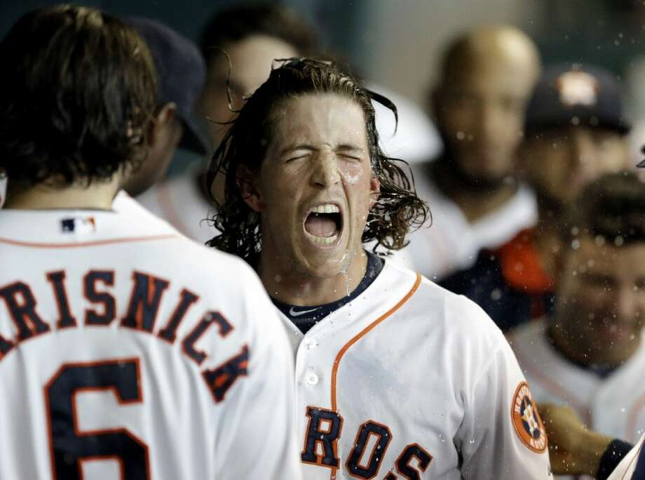 The Astros' Colby Rasmus shakes water from his face after unloading a two-run home run in the third inning Sunday against the Rangers. The Astros won 10-0 at Minute Maid Park.