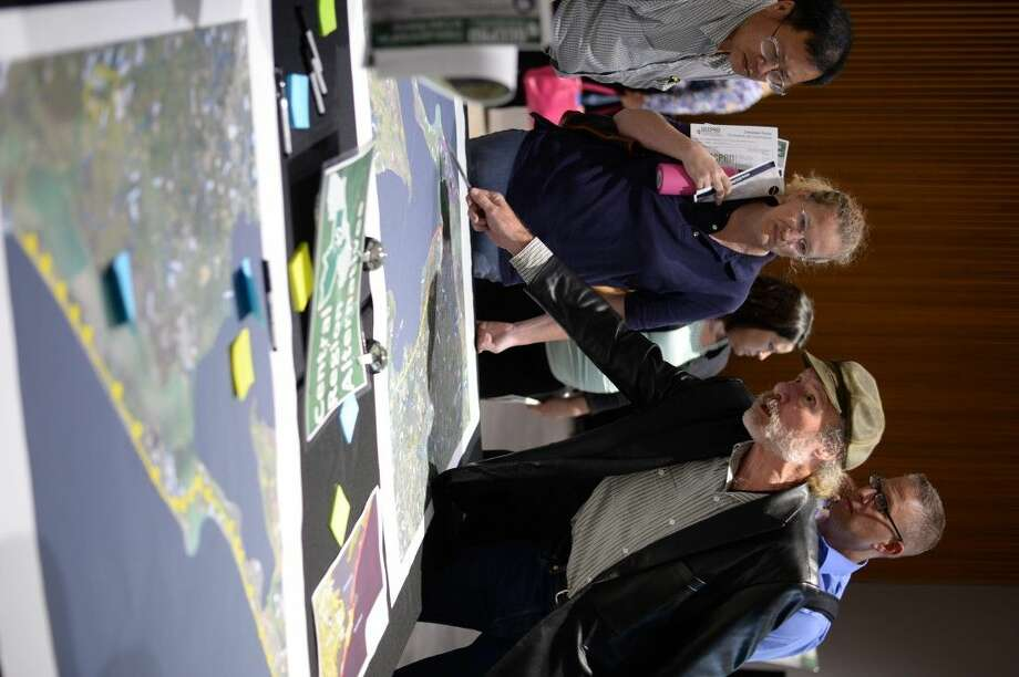 The Gulf Coast Community Protection and Recovery District hosted an open meeting last Tuesday in League City for residents to get an up close look at the developing stage of designing a protective shield against storm surge.