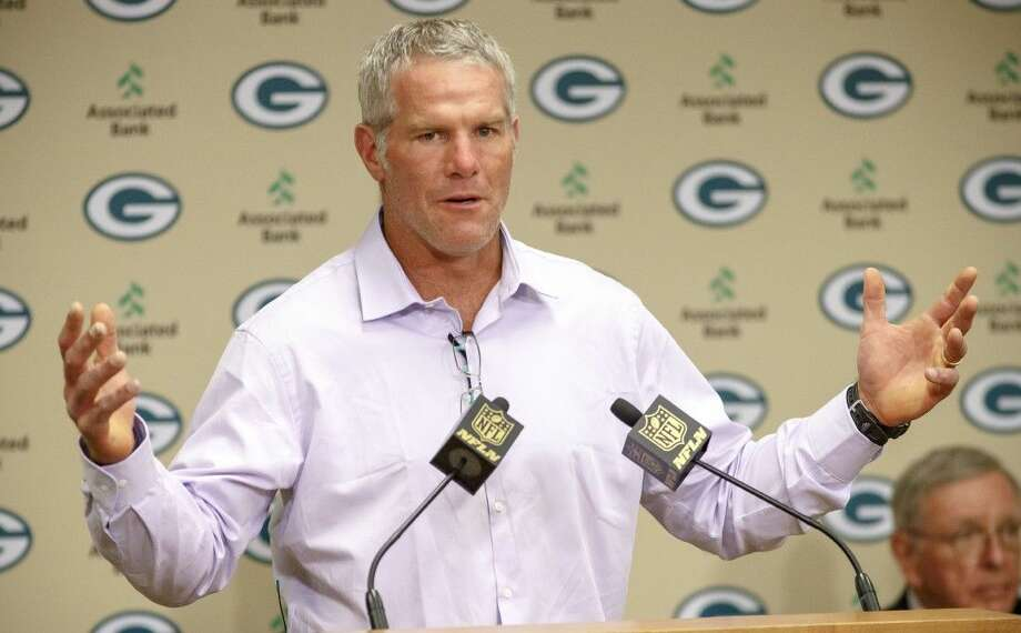 Former Green Bay Packers NFL football quarterback Brett Favre talks at a news conference prior to being inducted into the Packers Hall of Fame and having his No. 4 jersey retired Saturday at Lambeau Field in Green Bay, Wis.