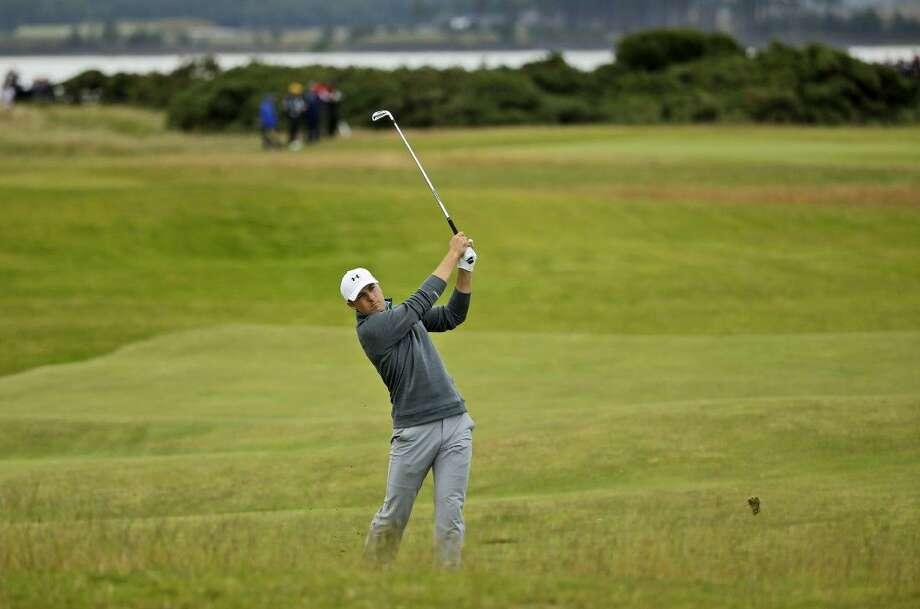 Jordan Spieth plays his second shot on the 13th hole during the third round of the British Open on Sunday.