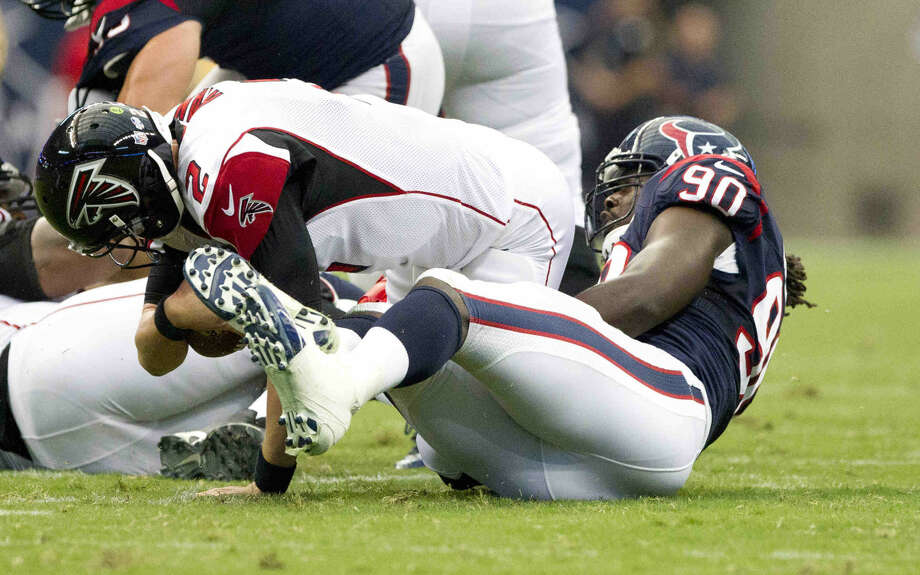 Houston Texans linebacker Jadeveon Clowney (90) sacks Atlanta Falcons quarterback Matt Ryan (2) in the first quarterback of an NFL preseason game at NRG Stadium Saturday. Go to HCNpics.com to view more photos from the game. Photo: Jason Fochtman