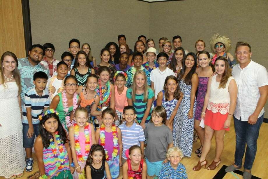 The Covington Woods Swim Team finished undefeated in Southwest Houston Recreational Swim League competition and sent a record 49 swimmers to the 2015 SHRSL All-Star meet this season. Photo: Submitted Photo