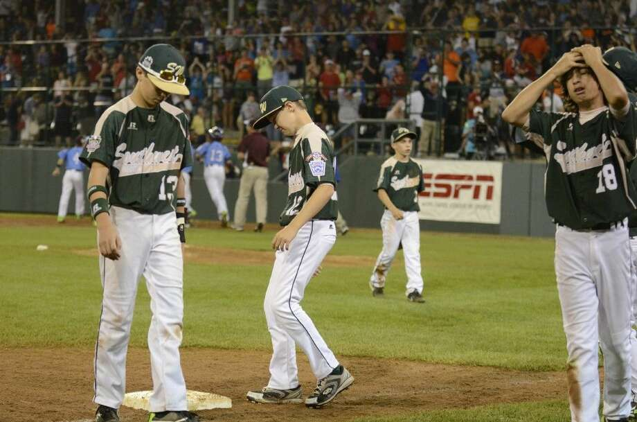 Pearland Little League players react to their loss to Mid-Atlantic in Williamsport, Pa. on Sunday, Aug. 17, 2014. (Ralph Wilson)