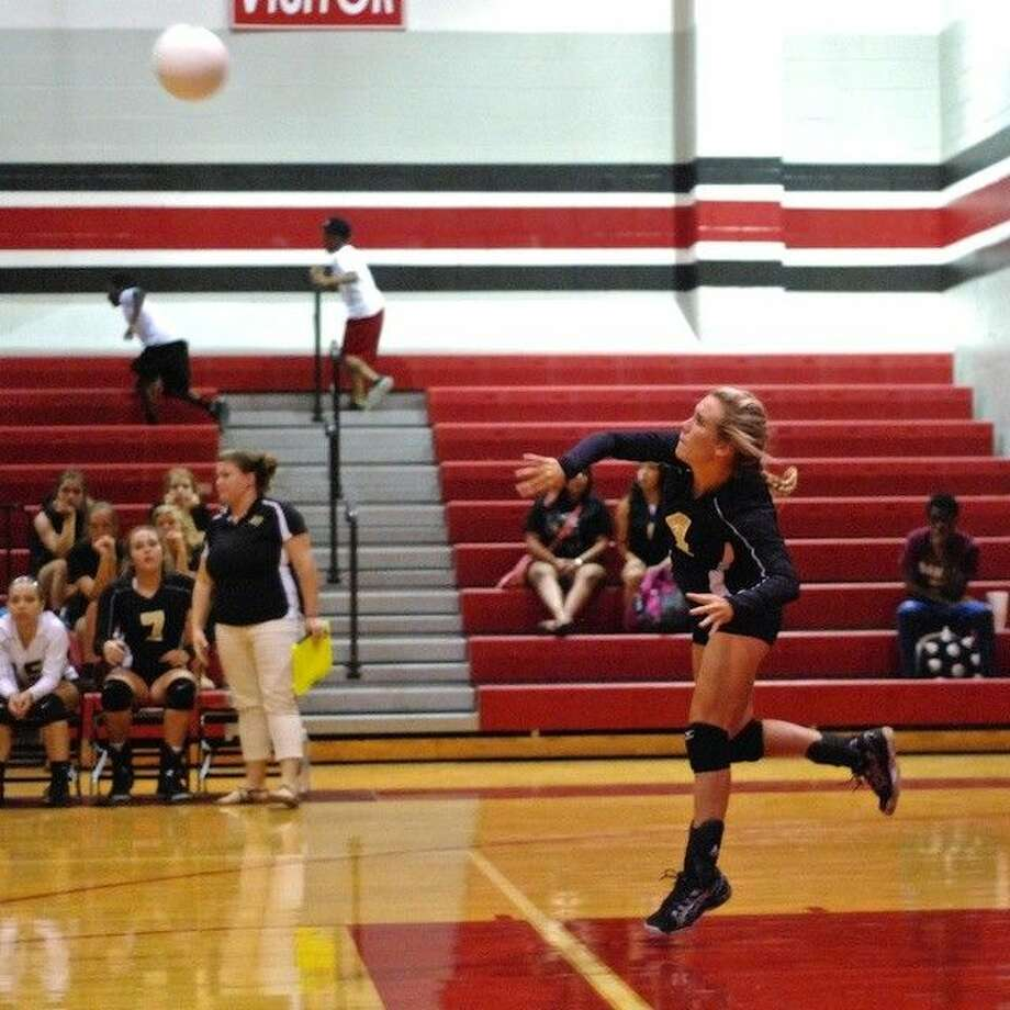 Cameron Bertrand (4) serves against Cleveland Friday, Aug. 15. Photo: CASEY STINNETT