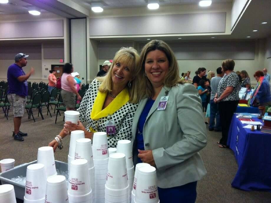 Dr. Jessica Johnson, Dayton ISD superintendent, and Assistant Superintendent Tami Pierce serve lemonade and cookies at the 2014 Parent Expo. Photo: STACEY GATLIN