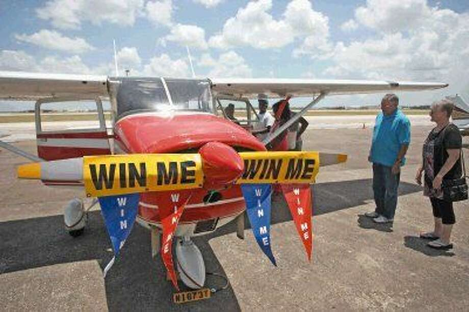 People view the vintage Cessna 172C which was the grand prize during a raffle for the 1940 Air Terminal Museum. Photo: Kar B Hlava