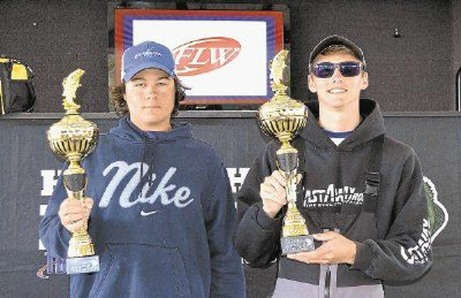 Chad Mrazek (left) and Joe Beebee pose with their trophies after winning the 2016 Texas High School Fishing State Championship.