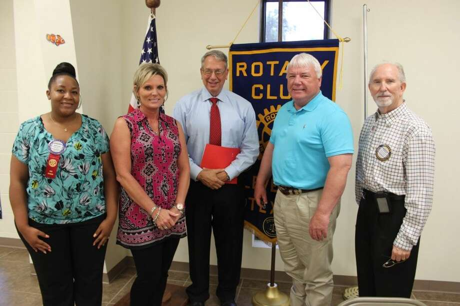 Sheriff Bobby Rader (center) was the guest speaker at the Aug. 13 luncheon of the Cleveland Rotary Club. Pictured with the sheriff (left to right) are Ashleigh Broussard, Kelly Jenkel-Axton, Cleveland ISD Superintendent Dr. Darrell Myers and Cleveland Rotary Club President Tommie Daniel. Broussard, Jenkel-Axton and Myers are the newest members of the Rotary Club. Photo: VANESA BRASHIER
