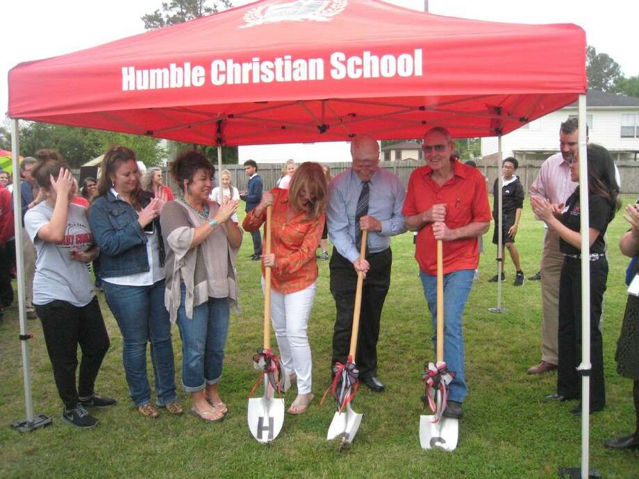 Armed with shovels, Humble Christian School representatives and members of the Boeker family celebrate the groundbreaking of the school's new gym Wednesday, March 30, 2016.